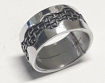 Aluminium ring with steel mesh window inside and custom text.