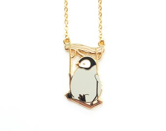 Baby Penguin on a Swing Necklace natelledrawsstuff