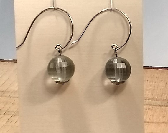 Faceted pale blue gray bead with a silver base, dangles on a circle, made from broken jewelry, handmade, upcycled, recycled, ooak