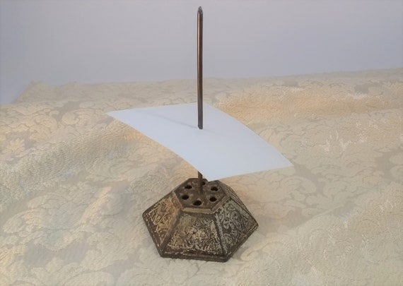 Cast iron paper spike or spindle for your receipts and desk papers. Lovely finish,  old patina