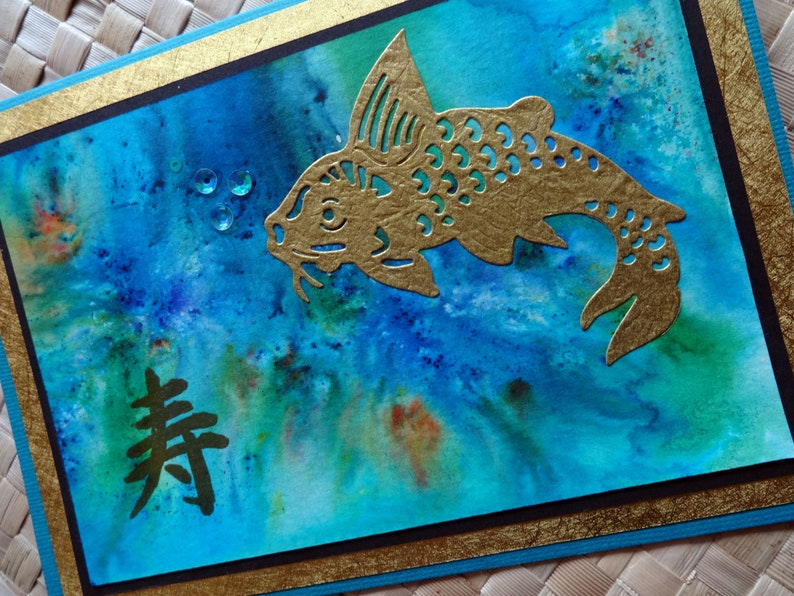 Oriental birthday card with koi and kotobuki longevity symbol