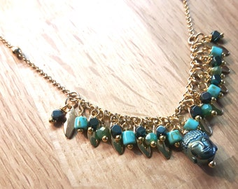 Thin golden necklace with charms, glass tassels, Buddha head pearl, Ka'Ula choker necklace