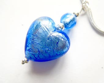 Blue Murano glass pendant with sterling silver chain.