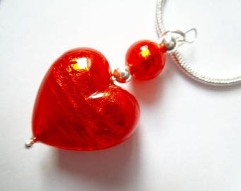 Red Murano glass heart pendant with sterling silver chain.