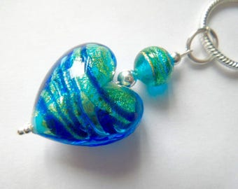 A blue and green Murano glass heart pendant with sterling silver.