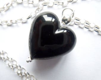 Black Murano glass heart pendant with sterling silver.