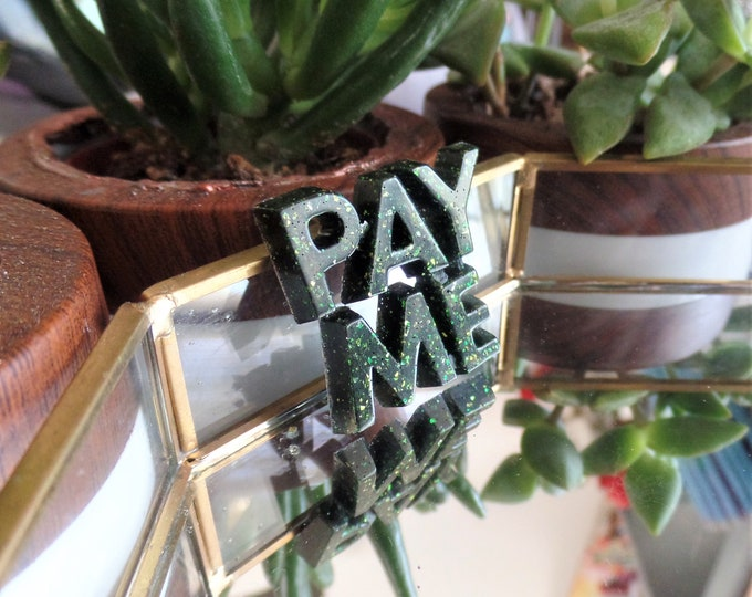 Black Emerald PAY ME Pin
