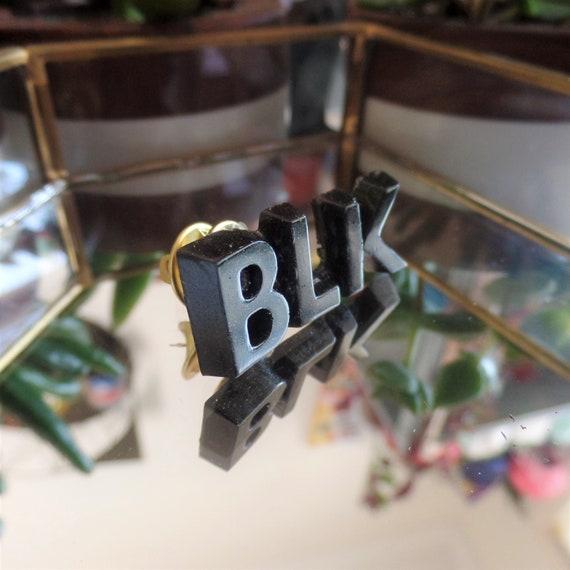 Black BLK Pin