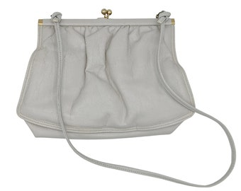 Vintage pale gray leather purse with gold tone metal and long thin strap