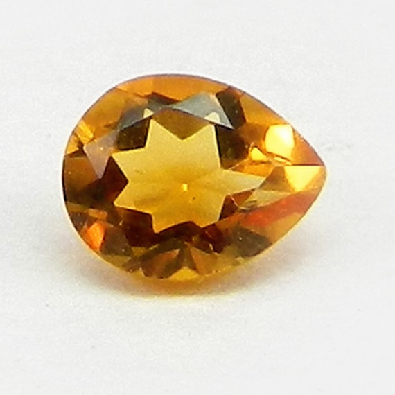 NATURAL MADEIRA CITRINE 11 MM TRILLION CUT
