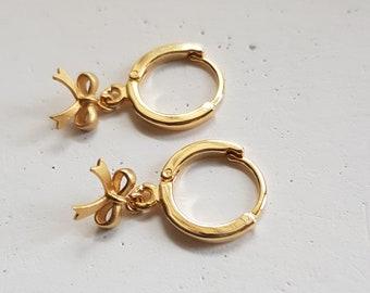 huggie hoop earrings with charm bow hoop earrings
