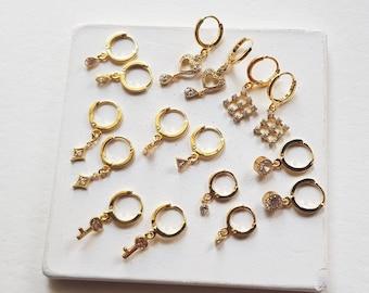 gold hoop earrings with charm, huggie earrings with charm,