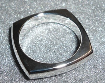 Cut in the mass seamless square sided domed sterling silver ring