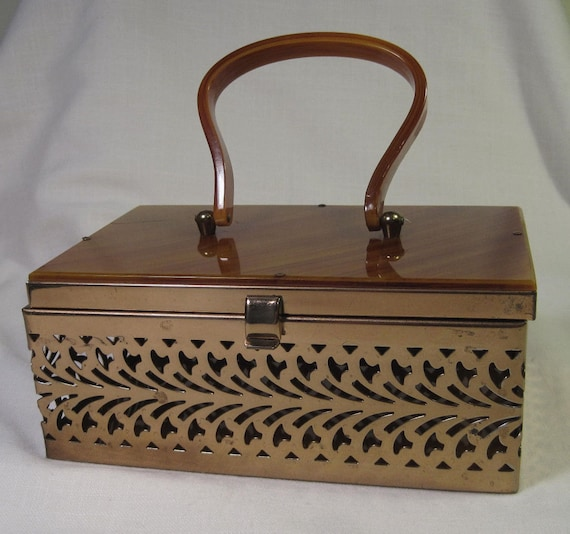 Gorgeous Metal Cut Box Purse with Amber Lucite Top and Handle.