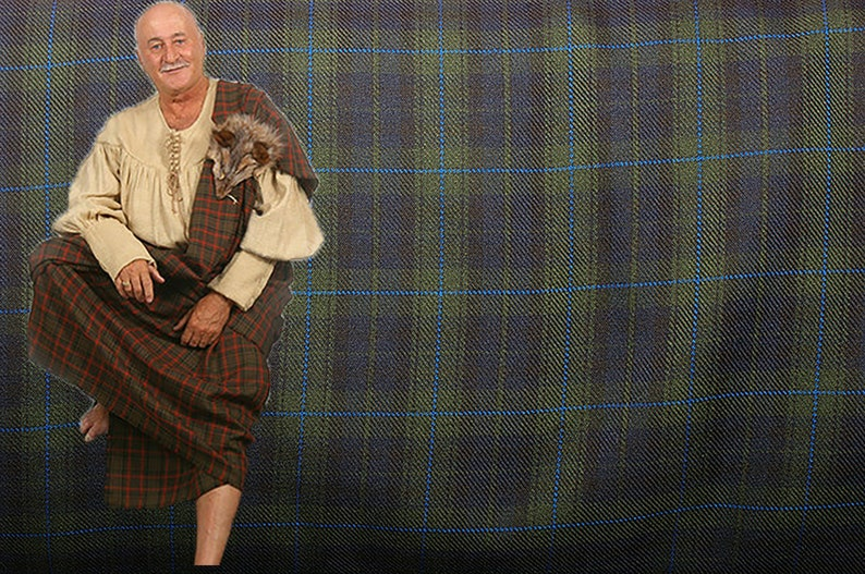 Medieval men great and pleated kilt, Plaid tartan fabric, Ancient highlander