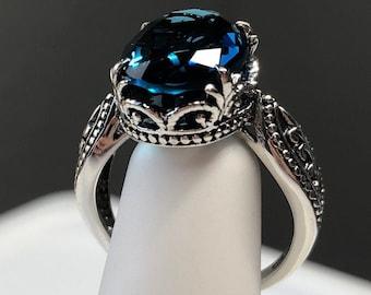 London Topaz Ring/ Sterling Silver/ 6ct Oval Cut Vibrant Blue Gemstone Dragon Claw Steampunk Filigree [Custom Made] Design#133