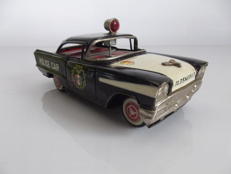 Vintage 1958 Ichiko Japan Oldsmobile tin toy police car | Etsy