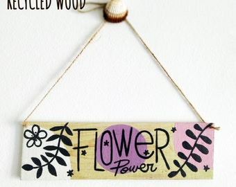 Flower power, decorative print on recycled wood. Sustainable decoration