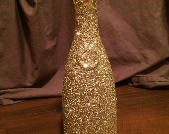 Gold glitter wine carafe vase