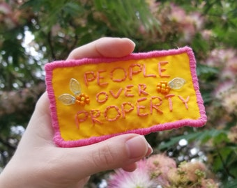 People Over Property Hand Sewn Patch Pin - Stainless Steel Pin Back Embroidered Brooch