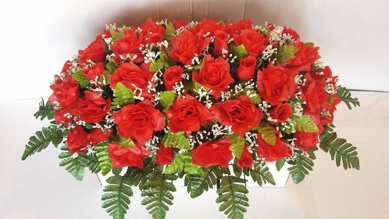 Large Red rose Memorial saddle with baby/'s breath and greenery.