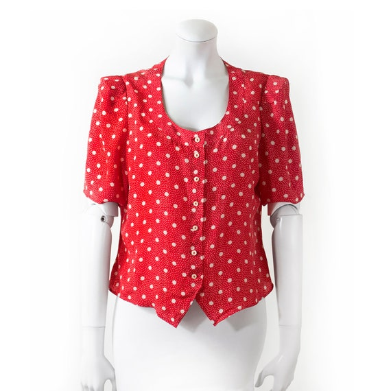 CACHAREL shoulder blouse, red background, white do