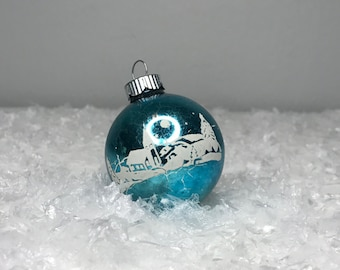 vintage blue glass Christmas ornament with winter scene