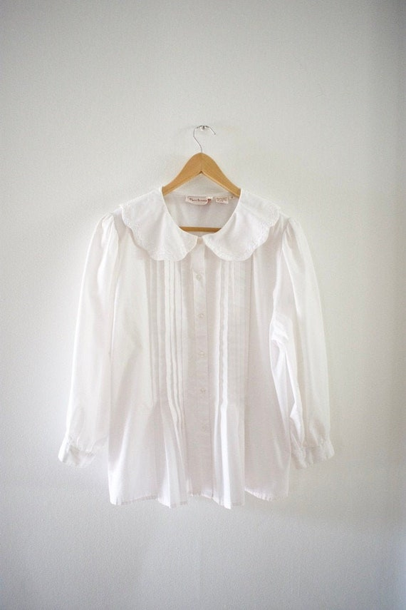 White shirt with a peter pan collar