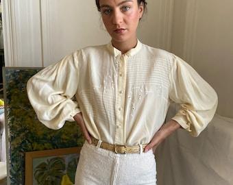 1970s Emmanuelle Khanh cream silk blouse, tiny high collar, embroideries, wide long sleeves / medium