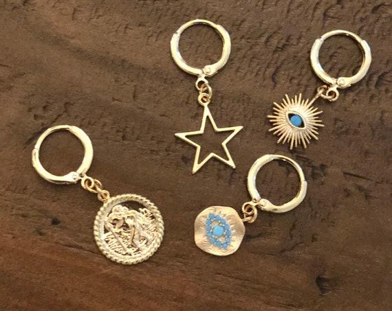 huggie earrings. hoop earrings. evil eye. star, small hoops.
