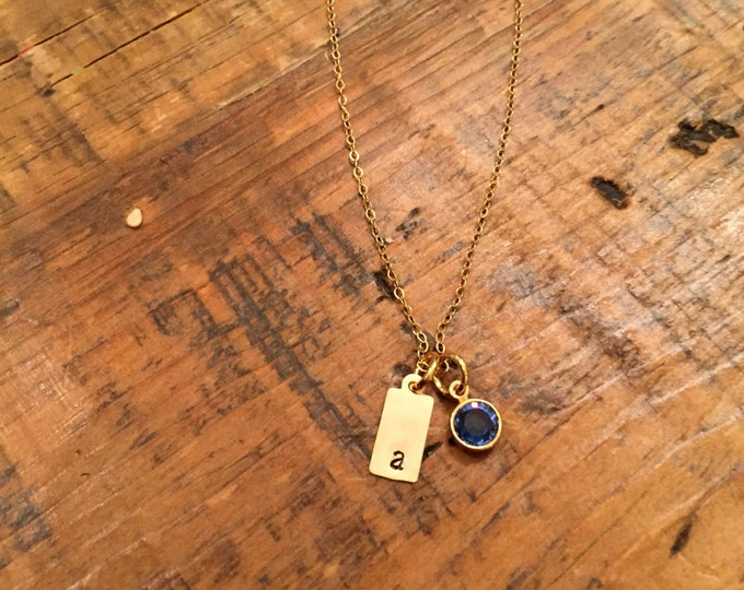 Tag You're It Necklace. Simple hand stamped personalized 14k gold fill initial tag. Swarovski birthstone.