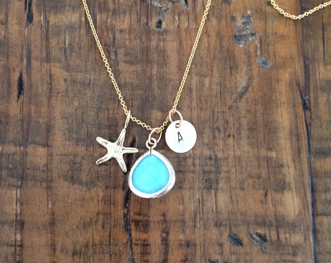 The Sea, Stars and Me. 14k gold filled or Sterling Silver. Baby blue glass stone pendant with starfish and choice of initial. Hand stamped.