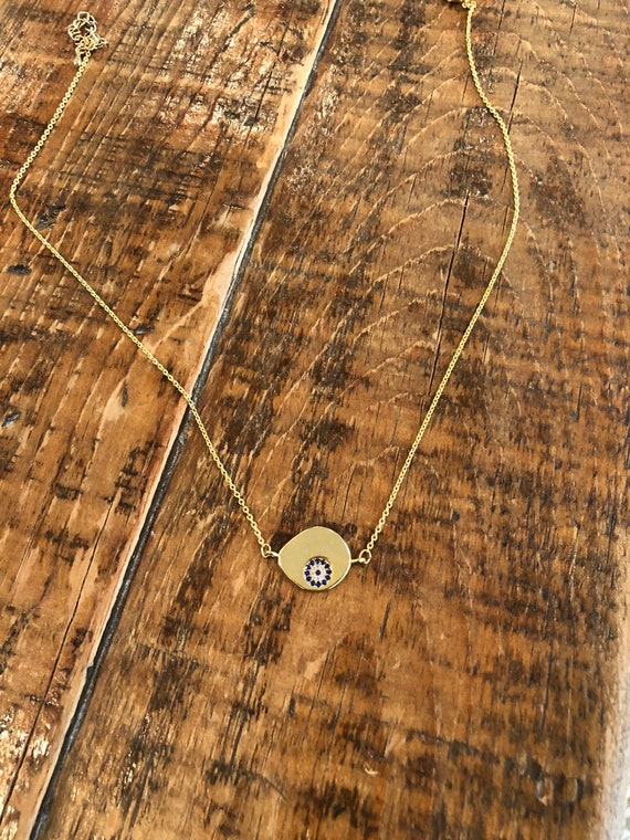 gold evil eye pendant necklace