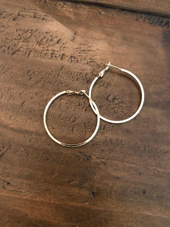 gold hoop earring. shiny gold hoop leverback earring