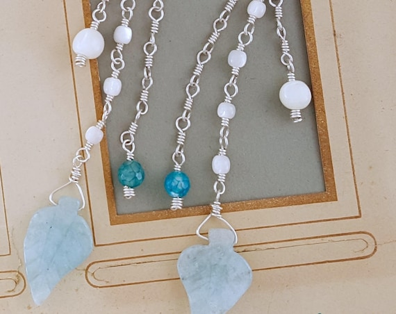 Malibu Summer Statement Earrings Long beaded dangle earrings with craved chalcedony leaves on beaded chain