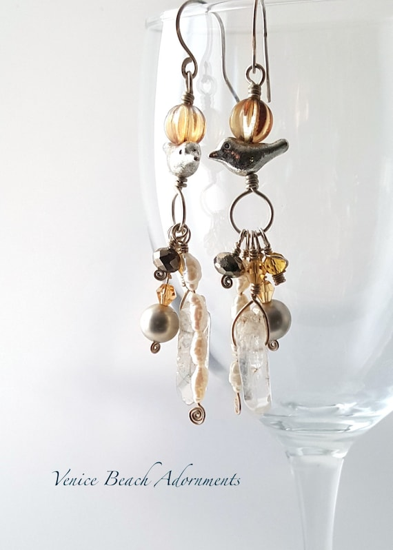 Handmade silver dangle earrings with crystal points, pearls, and bird charm
