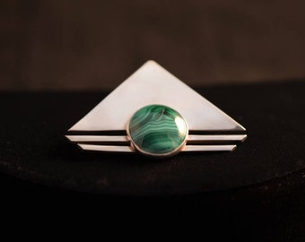 Modernist sterling silver and malachite brooch. Marked sterling and signed PTP