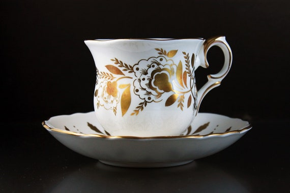 Footed Teacup and Saucer, Crown Staffordshire, England, Bone China, Gold Floral,  22 Kt. Gold Trim, Rare