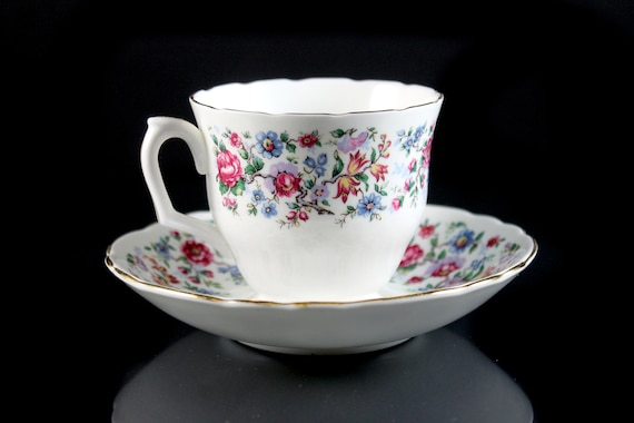 Footed Teacup and Saucer, Staffordshire, Springtime, England, Bone China, Floral Pattern, 22 Kt. Gold Trim