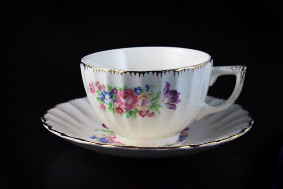 Teacup and Saucer, Leigh Potters, Leigh Ware, Center Floral, Brushed Gold Trim