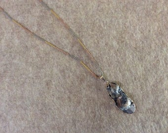 Geode pendant on tri colored silver chain