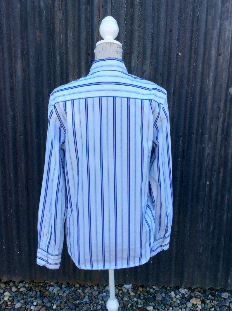 Vintage Tommy Hilfiger striped shirt in a size Medium