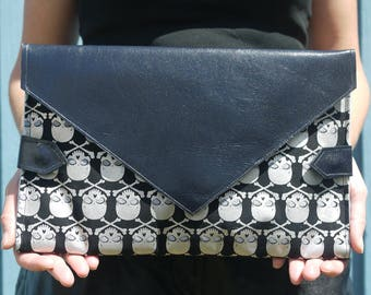 Silver skulls with midnight blue leather diaper clutch, folds into pink baby changing mat, diaper purse, nappy bag, baby shower gift