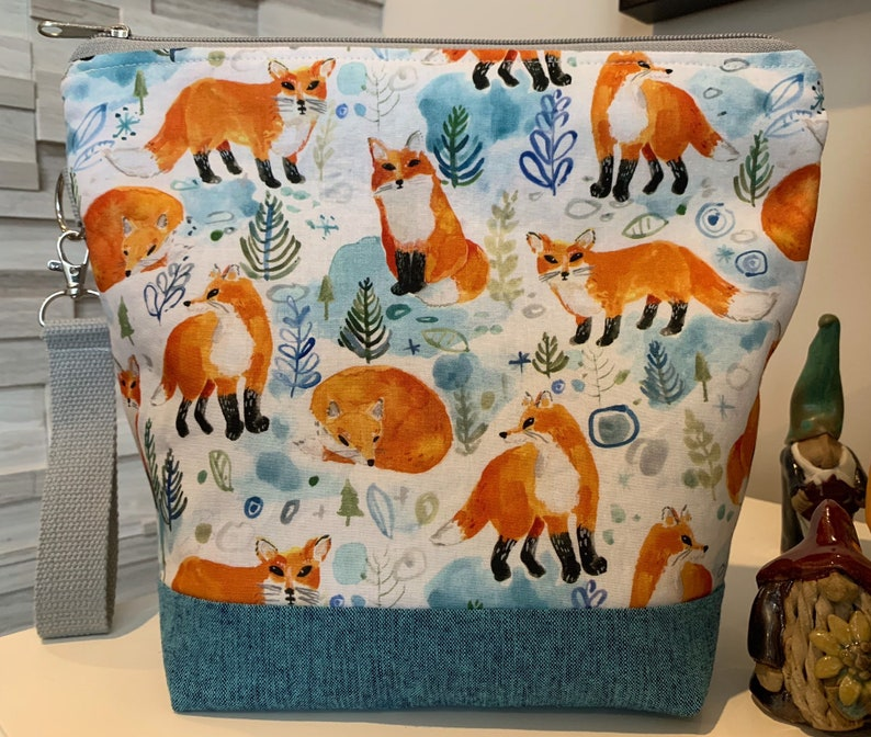 Foxes in Snow Knitting Project Bag with removable clip fob. image 0