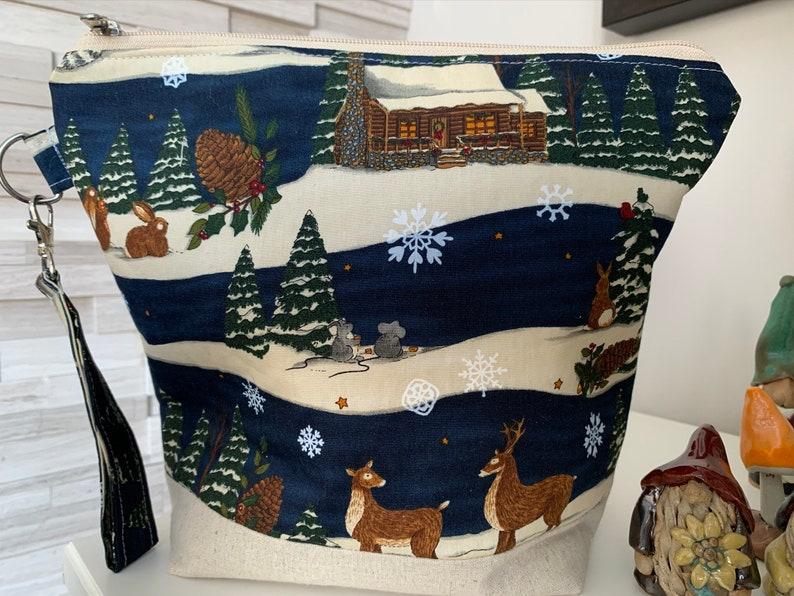 Winter log cabin and woodland animals navy/beige  Knitting image 0
