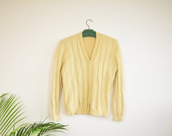 Soft yellow knitted vest vintage