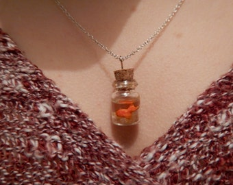 Pendant: small goldfish made and hand painted swimming in a bottle