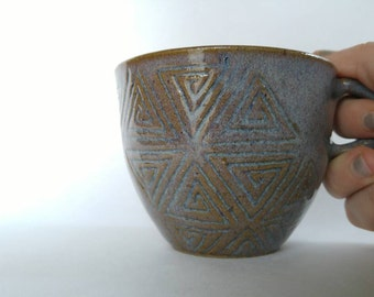 Hand carved purple ceramic coffee cup with spiral pattern- wheel thrown pottery mug