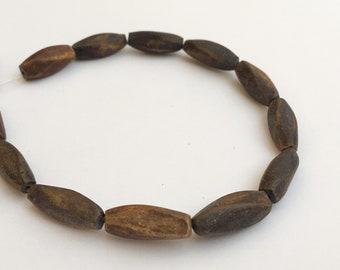 "Burnt horn beads 6x17 twist 8"" strand"