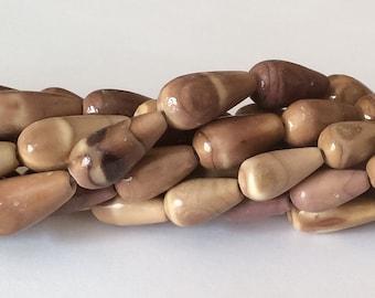 "Natural shell beads, sea urchin teardrop beads 16"" strand"